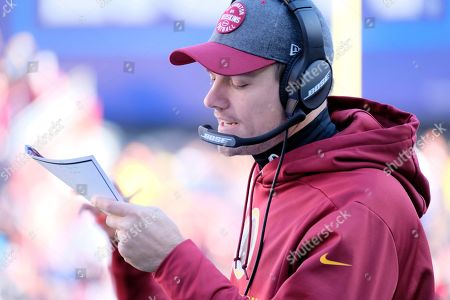 Washington Redskins offensive coordinator Kevin O'Connell calls a play during an NFL football game against the Detroit Lions, in Landover, Md