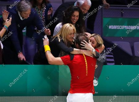 Spain's Rafael Nadal (C) celebrates with his mother Ana Maria Parera (C-L) after defeating Canada's Denis Shapovalov in the Davis Cup Finals tennis tournament final tie between Canada and Spain at the Caja Magica facilities in Madrid, Spain, 24 November 2019.