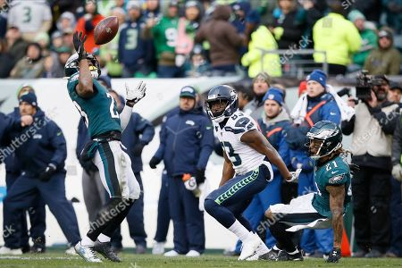 Philadelphia Eagles' Rodney McLeod (23) intercepts a pass as Seattle Seahawks' David Moore (83) and Ronald Darby (21) look on during the second half of an NFL football game, in Philadelphia