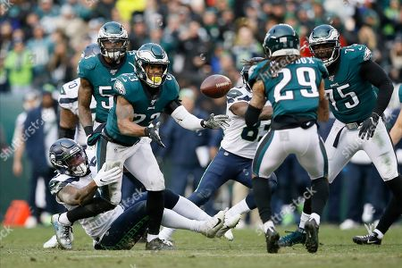 Philadelphia Eagles' Rodney McLeod (23) tosses a intercepted pass to Avonte Maddox (29) during the second half of an NFL football game against the Seattle Seahawks, in Philadelphia
