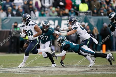 Seattle Seahawks' Rashaad Penny (20) runs for a touchdown pass Philadelphia Eagles' Malcolm Jenkins (27) and Rodney McLeod (23) during the second half of an NFL football game, in Philadelphia