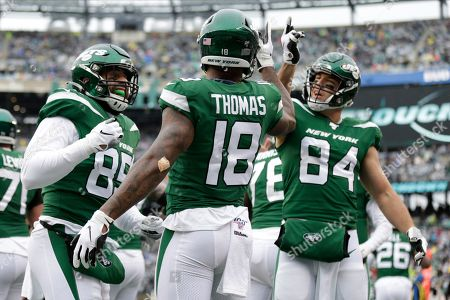 New York Jets wide receiver Demaryius Thomas (18) celebrates with teammates after scoring a touchdown during the first half of an NFL football game against the Oakland Raiders, in East Rutherford, N.J