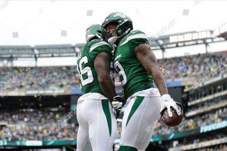 New York Jets wide receiver Demaryius Thomas, right, celebrates with teammate Le'Veon Bell after scoring a touchdown during the first half of an NFL football game against the Oakland Raiders, in East Rutherford, N.J
