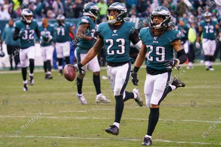 Philadelphia Eagles free safety Rodney McLeod (23) celebrates his interception with cornerback Avonte Maddox (29), who he tossed the ball to for more yards, during the NFL game between the Seattle Seahawks and the Philadelphia Eagles at Lincoln Financial Field in Philadelphia, Pennsylvania