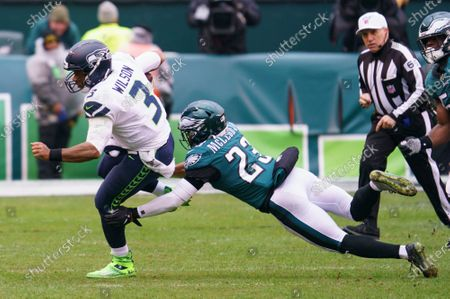 Seattle Seahawks quarterback Russell Wilson (3) in action against Philadelphia Eagles free safety Rodney McLeod (23) during the NFL game between the Seattle Seahawks and the Philadelphia Eagles at Lincoln Financial Field in Philadelphia, Pennsylvania