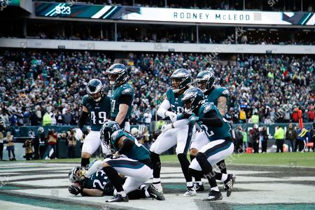 Philadelphia Eagles' Rodney McLeod (23) celebrates with teammates after intercepting a pass during the second half of an NFL football game against the Seattle Seahawks, in Philadelphia