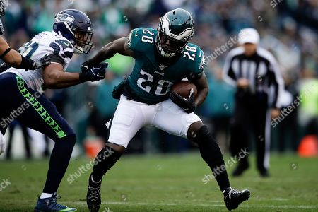 Stock Picture of Philadelphia Eagles' Jay Ajayi runs past Seattle Seahawks' K.J. Wright during the first half of an NFL football game against the Seattle Seahawks, in Philadelphia
