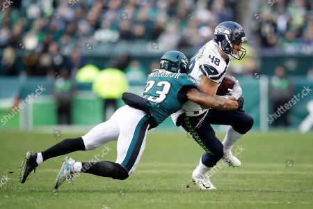 Seattle Seahawks' Jacob Hollister (48) is tackled by Philadelphia Eagles' Rodney McLeod (23) during the second half of an NFL football game, in Philadelphia