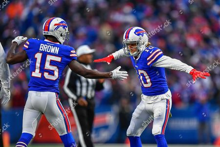 Buffalo Bills wide receiver Cole Beasley (10) celebrates with wide receiver John Brown (15) after scoring a touchdown against the Denver Broncos during the fourth quarter of an NFL football game, in Orchard Park, N.Y
