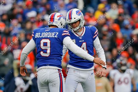 Buffalo Bills kicker Stephen Hauschka (4) celebrates with punter Corey Bojorquez (9) after kicking a field goal against the Denver Broncos during the first quarter of an NFL football game, in Orchard Park, N.Y