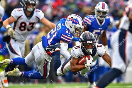 Denver Broncos wide receiver Diontae Spencer (11) is tackled by Buffalo Bills free safety Jordan Poyer (21) during the third quarter of an NFL football game, in Orchard Park, N.Y