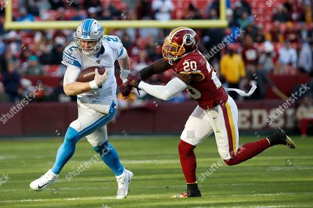 Detroit Lions quarterback Jeff Driskel (2) scrambles as Washington Redskins strong safety Landon Collins (20) tries to bring him down during the second half of an NFL football game, in Landover, Md