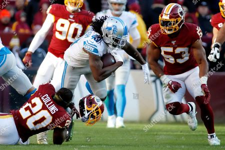 Washington Redskins strong safety Landon Collins (20) loses his helmet while tackling Detroit Lions running back Bo Scarbrough (43) during the second half of an NFL football game, in Landover, Md