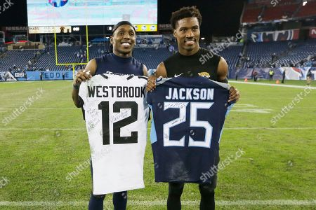 Tennessee Titans cornerback Adoree' Jackson, left, trades jerseys with Jacksonville Jaguars wide receiver Dede Westbrook after an NFL football game, in Nashville, Tenn. The Titans won 42-20