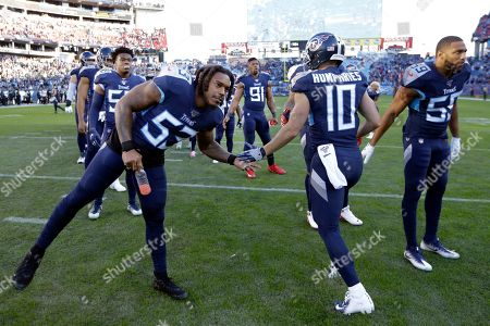Tennessee Titans wide receiver Adam Humphries (10) shakes hands with linebacker Daren Bates (53) and inside linebacker Wesley Woodyard (59) before an NFL football game, in Nashville, Tenn