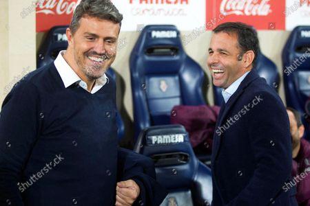 Celta's head coach Oscar Garcia (L) greets Villarreal's head coach Javi Calleja (R) before the Spanish La Liga soccer between Villarreal CF and Celta Vigo at Estadio de la Ceramica stadium in Villarreal, eastern Spain, 24 November 2019.