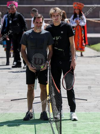 Swiss tennis players Roger Federer (L) and German tennis player Alexander Zverev (R) participate in an exhibition on a 'mini-court' located on the planet's equator, in the Middle of the World citadel, in Quito, Ecuador, 24 November 2019. Federer and Zverev are in Quito as part of their Latin American tennis exhibition tour.