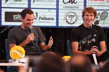 Swiss tennis player Roger Federer (L) and German tennis player Alexander Zverev (R) participate in a press conference, in the Middle of the World citadel, in Quito, Ecuador, 24 November 2019. Federer and Zverev are in Quito as part of their Latin American tennis exhibition tour.