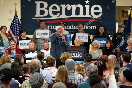 Democratic presidential candidate Sen. Bernie Sanders, I-Vt., points as he takes a question from a member of the audience during a campaign stop, in Hillsboro, N.H