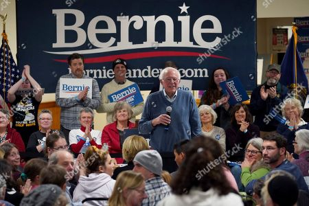 Democratic presidential candidate Sen. Bernie Sanders, I-Vt., smiles as he listens to a question from the audience during a campaign stop, in Hillsboro, N.H