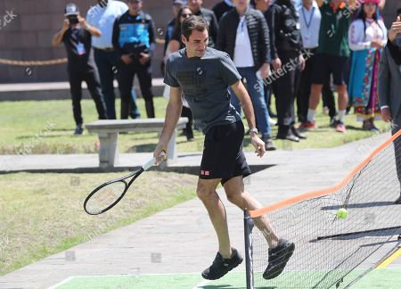 Swiss Roger Federer plays for few minutes after a press conference at Mitad del Mundo on the equator in Quito, Ecuador. . Federer and Alexander Zverev will hold an exhibition game tonight. For Federer this will be his first time in Ecuador