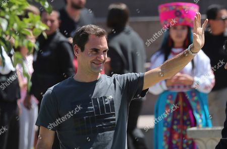 Swiss Roger Federer waves at fans during an exhibition game with Alexander Zverev at Mitad del Mundo on the equator in Quito, Ecuador, . Federer and Zverev will hold an exhibition game tonight. For Federer this will be his first time in Ecuador