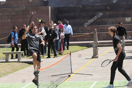 Swiss Roger Federer, left, and German Alexander Zverev play for few minutes after a press conference at Mitad del Mundo on the equator in Quito, Ecuador. . Federer and Zverev will hold an exhibition game tonight. For Federer this will be his first time in Ecuador
