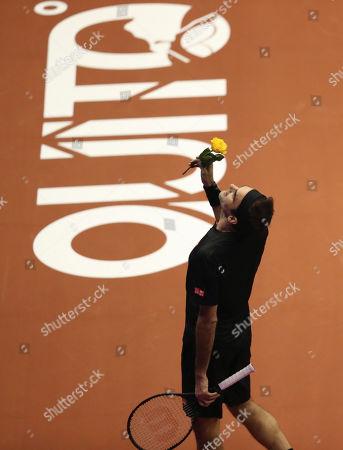 Roger Federer celebrates a poin during an exhibition game with Alexander Zverev at Rumiñahui Coliseum in Quito, Ecuador