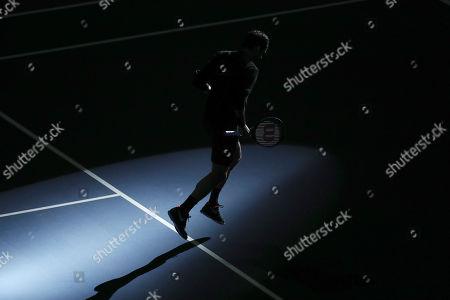 Roger Federer enter the tennis court for an exhibition game with Alexander Zverev at Rumiñahui Coliseum in Quito, Ecuador