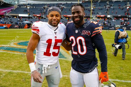 New York Giants wide receiver Golden Tate (15) and Chicago Bears cornerback Prince Amukamara (20) meet following an NFL football game in Chicago, . The Bears defeated the Giants 19-14