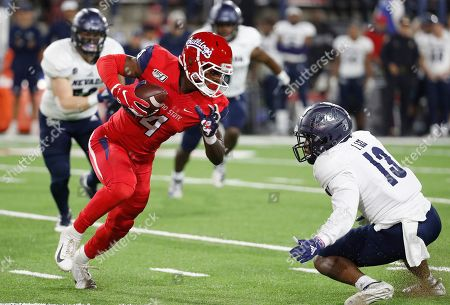 Emoryie Edwards, Jordan Lee. Fresno State wide receiver Emoryie Edwards tries to run past Nevada defensive back Jordan Lee during the first half of an NCAA college football game in Fresno, Calif