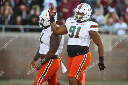 Miami defensive lineman Jordan Miller (91) celebrates after Florida State quarterback Alex Hornibrook (not pictured) was sacked in the fourth quarter of an NCAA college football game, in Tallahassee, Fla. Miami won 27-10