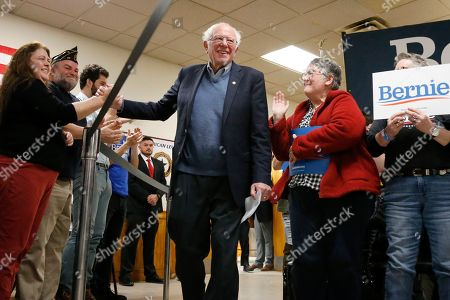 Democratic presidential candidate Sen. Bernie Sanders, I-Vt., greats members of the audience as he is introduced at a campaign stop, in Hillsboro, N.H