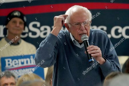 Democratic presidential candidate Sen. Bernie Sanders, I-Vt., points to his head as he speaks during a campaign stop, in Hillsboro, N.H