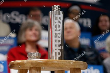 A water bottle for Democratic presidential candidate Sen. Bernie Sanders, I-Vt., sits on a stool ahead of Sanders arrival during a campaign stop, in Hillsboro, N.H