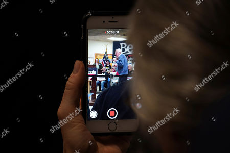 A member of the audience records Democratic presidential candidate Sen. Bernie Sanders, I-Vt., on her smartphone as he speaks during a campaign stop, in Hillsboro, N.H
