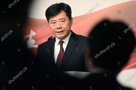 The Ambassador of China to Germany Wu Ken delivers a speech during the photo exhibition 'Striving for a better life' in Berlin, Germany, 24 November 2019. The Chinese Xinhua News Agency in Berlin organized the exhibition to celebrate the 70th anniversary of the People's Republic of China.