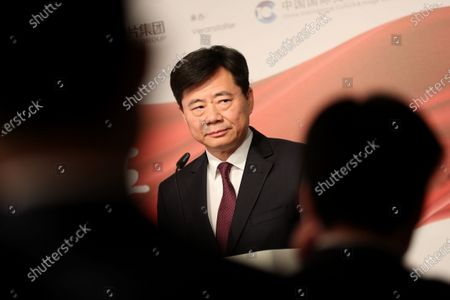 Stock Image of The Ambassador of China to Germany Wu Ken delivers a speech during the photo exhibition 'Striving for a better life' in Berlin, Germany, 24 November 2019. The Chinese Xinhua News Agency in Berlin organized the exhibition to celebrate the 70th anniversary of the People's Republic of China.