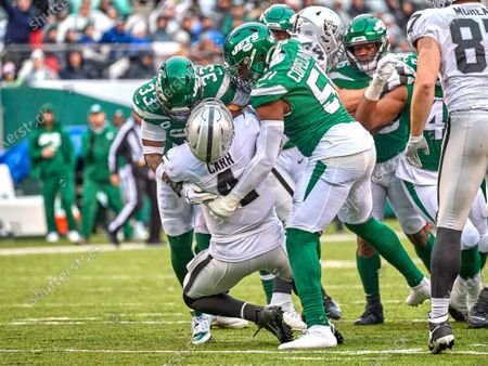 , 2019, East Rutherford, New Jersey, USA: Oakland Raiders quarterback Derek Carr (4) is sacked by New York Jets strong safety Jamal Adams (33) and outside linebacker Brandon Copeland (51) during a NFL game between the Oakland Raiders and the New York Jets at MetLife Stadium in East Rutherford, New Jersey