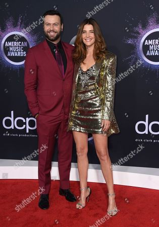 Stock Picture of Cobie Smulders, Taran Killam. Taran Killam, left, and Cobie Smulders arrive at the American Music Awards, at the Microsoft Theater in Los Angeles