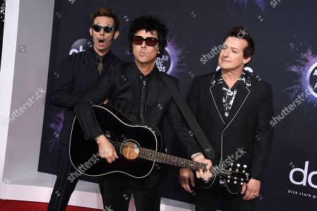 Mike Dirnt, Billie Joe Armstrong, Tre Cool. Mike Dirnt, from left, Billie Joe Armstrong and Tre Cool, of Green Day, arrive at the American Music Awards, at the Microsoft Theater in Los Angeles