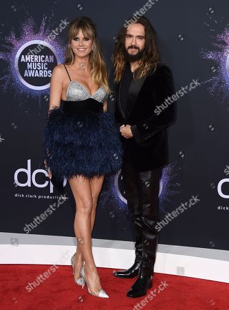 Heidi Klum, Tom Kaulitz. Heidi Klum, left, and Tom Kaulitz arrive at the American Music Awards, at the Microsoft Theater in Los Angeles