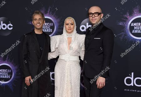 Stock Picture of Chad King,Christina Aguilera, Ian Axel. Chad King, from left, Christina Aguilera and Ian Axel arrive at the American Music Awards, at the Microsoft Theater in Los Angeles