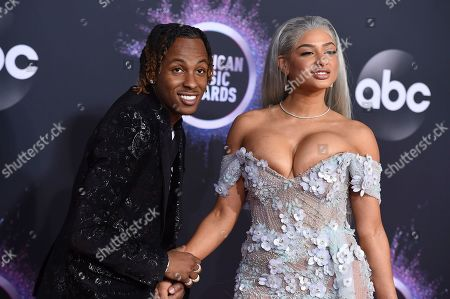 Rich the Kid, Tori Hughes. Rich the Kid, left, and Tori Hughes arrive at the American Music Awards, at the Microsoft Theater in Los Angeles
