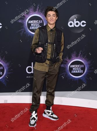 Asher Angel arrives at the American Music Awards, at the Microsoft Theater in Los Angeles