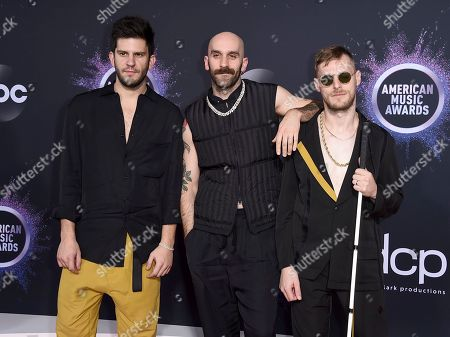 Stock Picture of Adam Levin, Sam Harris, Casey Harris. Adam Levin, from left, Sam Harris, and Casey Harris, of X Ambassadors, arrive at the American Music Awards, at the Microsoft Theater in Los Angeles