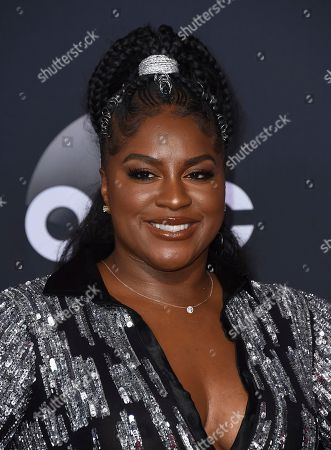 Ester Dean arrives at the American Music Awards, at the Microsoft Theater in Los Angeles