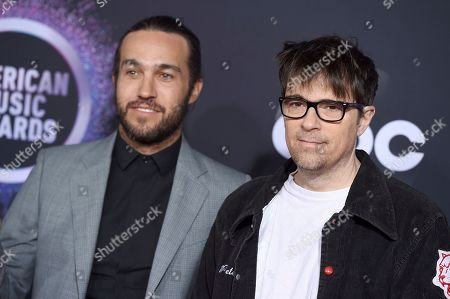 Stock Image of Pete Wentz, Rivers Cuomo. Pete Wentz, left, and Rivers Cuomo arrive at the American Music Awards, at the Microsoft Theater in Los Angeles