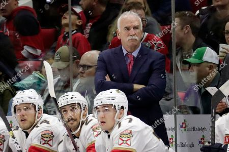 Florida Panthers' head coach Joel Quenneville watches the action during the second period of an NHL hockey game in Raleigh, N.C