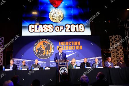 Todd Lichti, Terry Dischinger, Ernie DiGregorio, Homer Drew, Shane Battier, Calbert Cheaney. Inductees are introduced during a news conference for Collegiate Basketball Hall of Fame inductions in Kansas City, Mo., . Todd Lichti, left, Terry Dischinger, second from left, Ernie DiGregorio, third from left, Homer Drew, third from right, Shane Battier, second from right and Calbert Cheaney, right, along with representatives of Rich Majerus, Lute Olson and Larry Johnson, make up the class of 2019